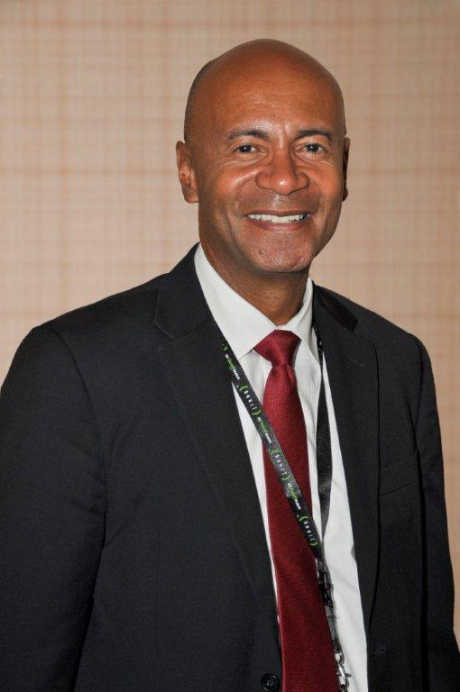 Mr. Julian Wilkins  (Chairman) : Director Telecoms Public Policy – Digicel Group